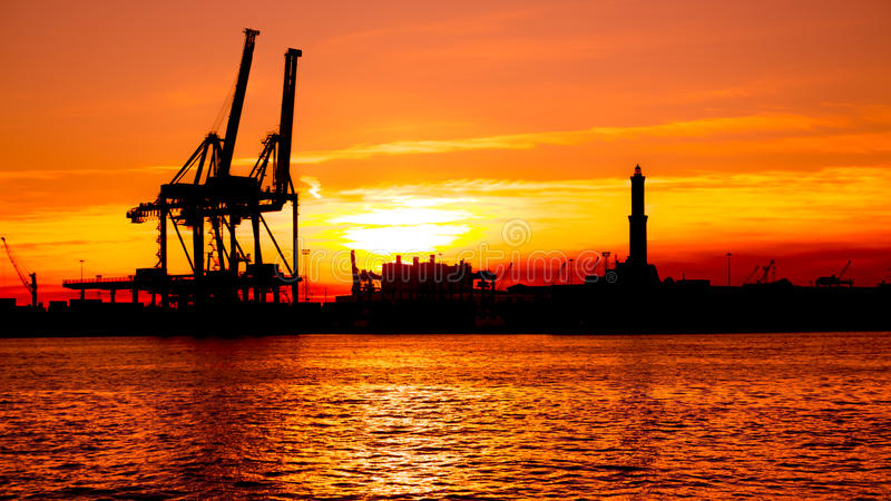 Sunset at Genoa`s port, silhouette of the Lanterna, Italy royalty free stock photography