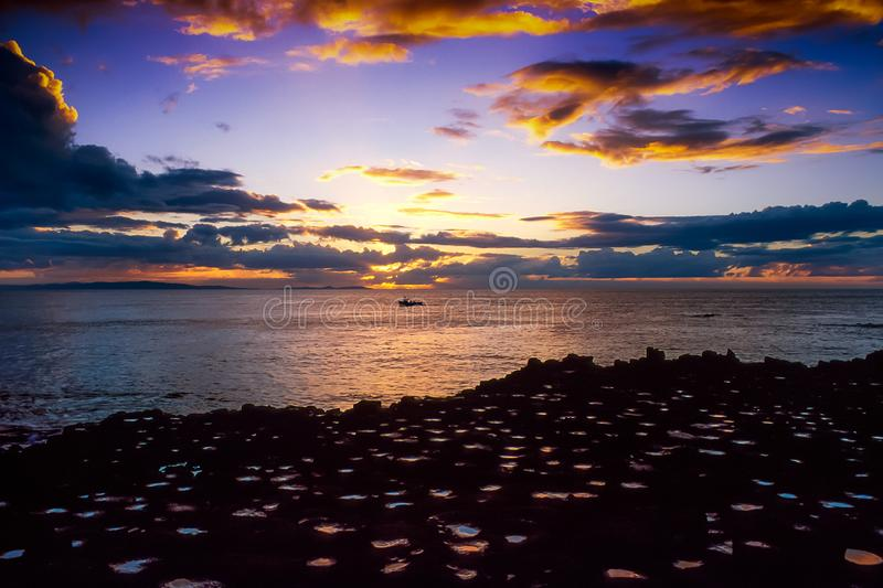 Sunset at the Giant`s Causeway. royalty free stock photography