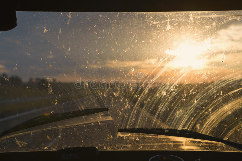Sunset through the glass of the car royalty free stock photography