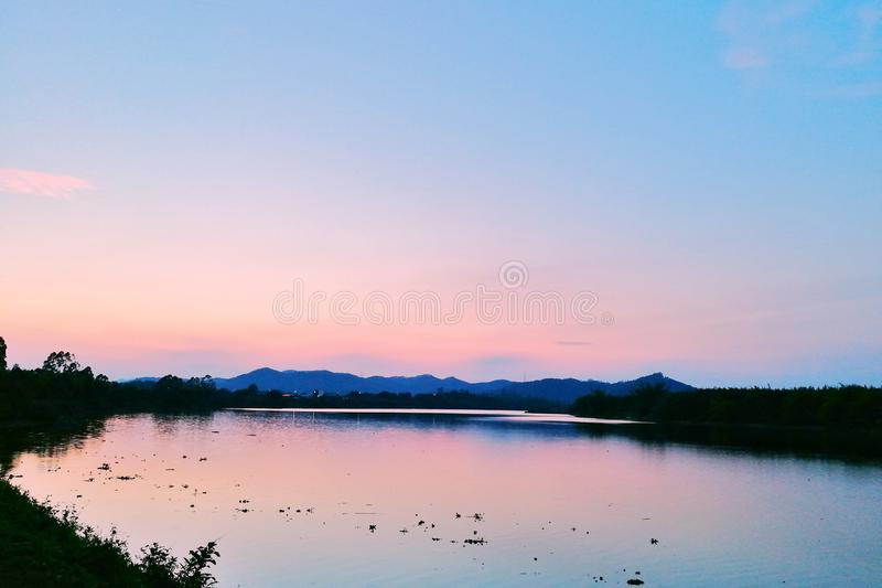 Sunset glow reflected in the water stock photo