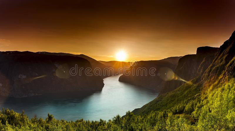 Sunset with golden light at a fjord in norway stock image