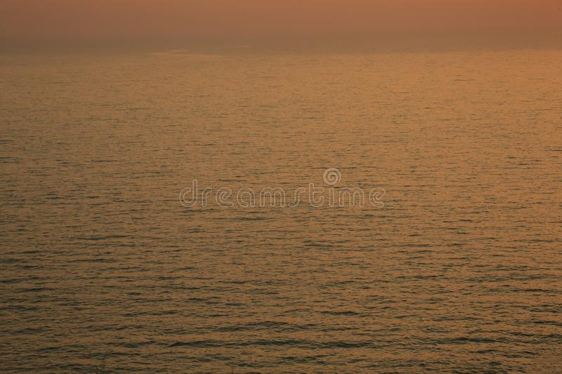 Sunset golden light reflection on sea wave ripple surface background. Abstract, tranquility, travel, serenity, romance, refresh, l stock photo