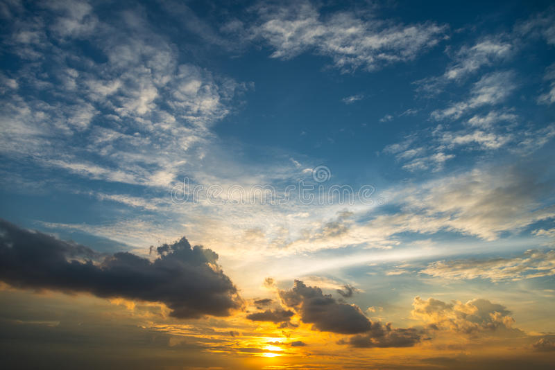 Sunset golden sunlight blue orange and yellow tone dusk sky stock photo