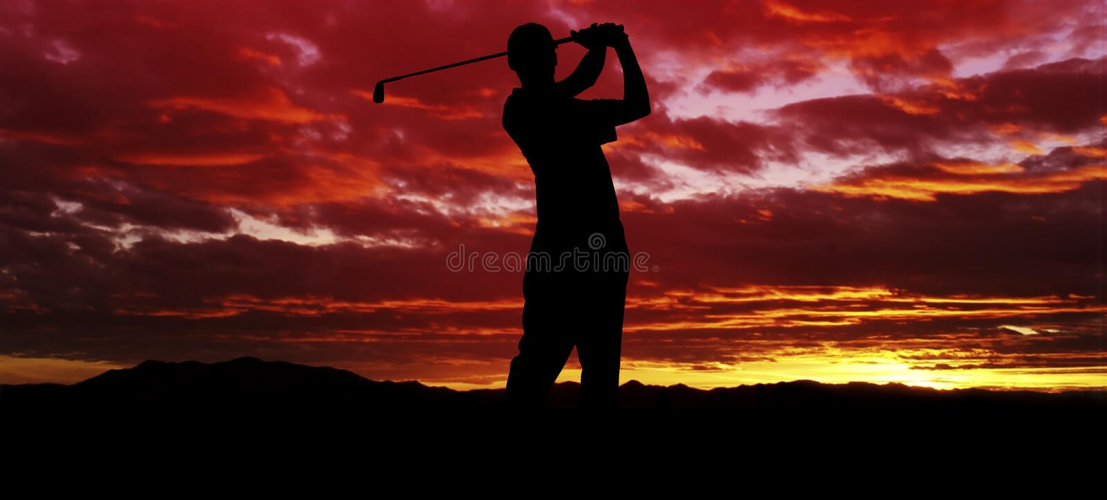 Sunset Golf Swing. A silhouette of a golfer swinging at sunset stock photos