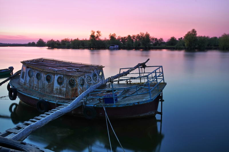 Danube River. Colored sunset landscape in natural reserve of the Danube Delta - landmark attraction in Romania. Colored gorgeous sunset landscape in natural stock photos