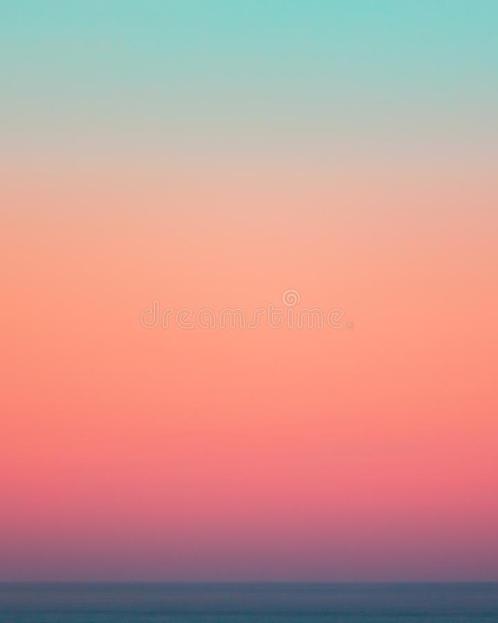 Sunset gradient over the ocean. At dusk consisting of a large spectrum of colours royalty free stock image