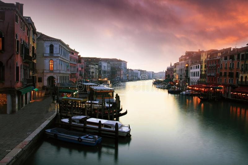 Sunset and the Grand Canal. Sunset of the Grand Canal viewed from the Rialto bridge in Venice stock photo
