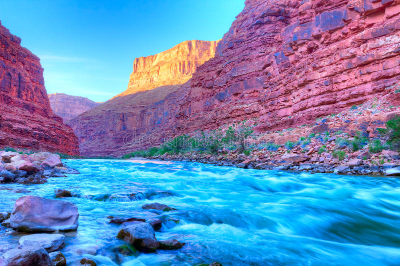 Sunset in Grand Canyon. Reflection in Colorado River of Butte catching days last rays, in Grand Canyon royalty free stock image