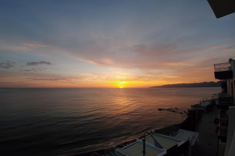 Sunset in greece. View from hotel on the first line of the sea. Sky water landscape nature ocean evening vacation europe horizon light island mediterranean royalty free stock photo