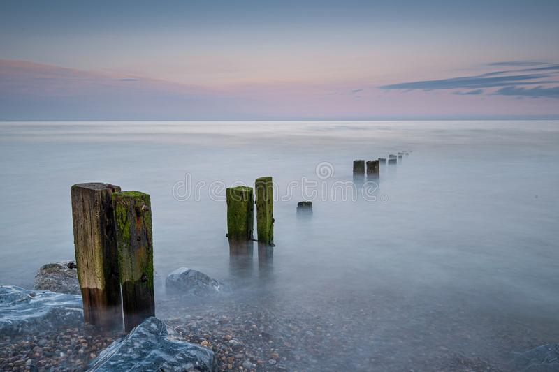 Sunset on the groynes royalty free stock photos