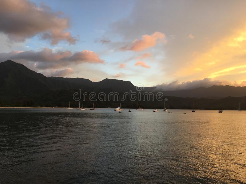 Sunset in Hanalei Bay in Summer on Kauai Island in Hawaii. stock photo