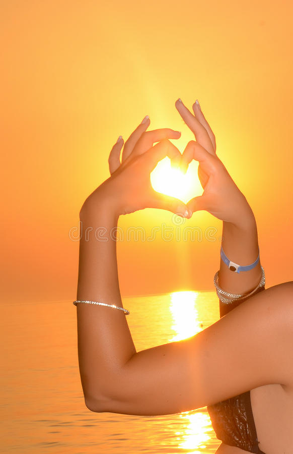 SUNSET HAND-POSED HEART stock image