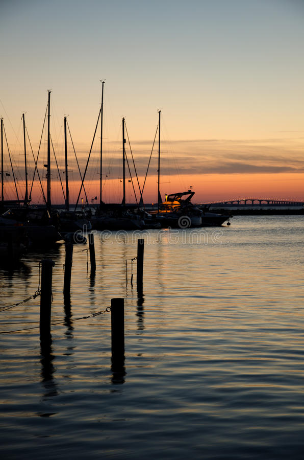 Sunset at harbor stock photography