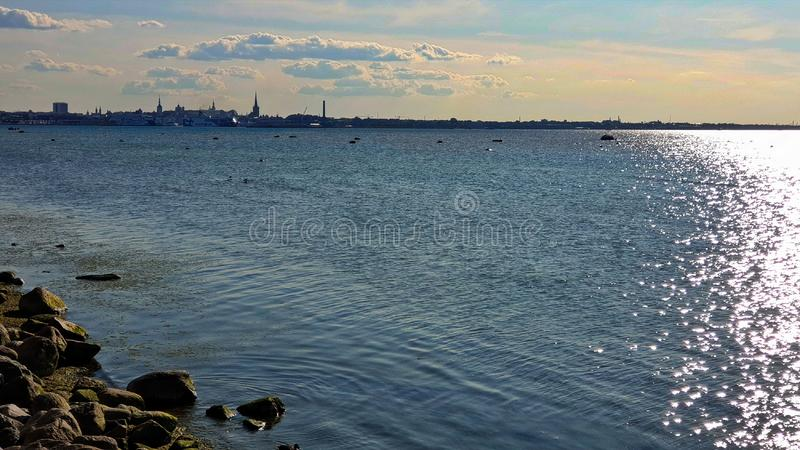 Sunset in  Harbor seascape evening sunset  in port Baltic Sea Estonia Tallinn sunlight  on water reflection bac. Beautiful nature seascape Sunset in Yachting royalty free stock image