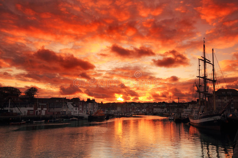 Sunset at the harbour royalty free stock photography