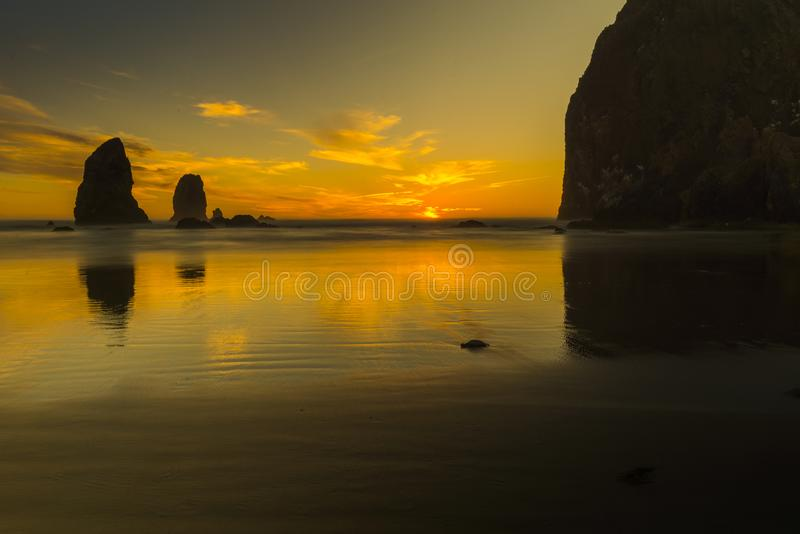 Sunset at Haystock Rockat Cannon Beach stock photography