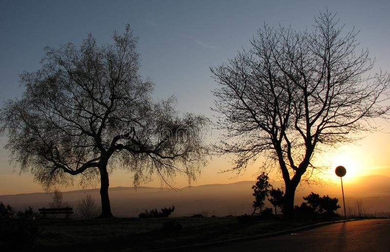 Download Sunset Hiding Behind The Traffic Sing Stock Image - Image: 4454625