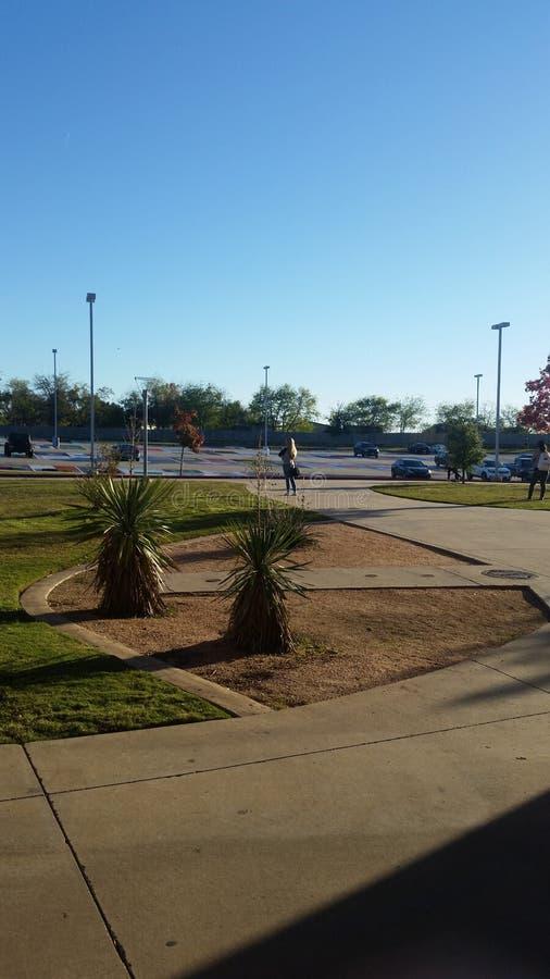 Sunset high school parking lot stock photo