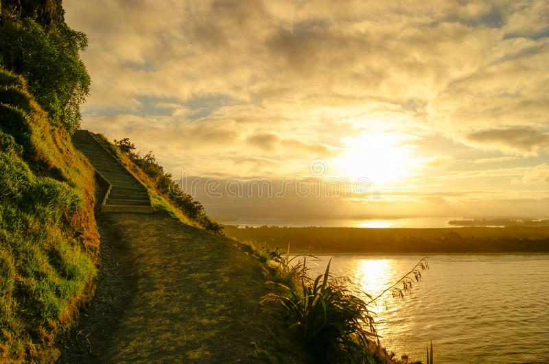 Sunset hill landscape hiking up mount maunganui in tauranga new zealand. Sunset hill landscape hiking up mount maunganui at tauranga new zealand royalty free stock images