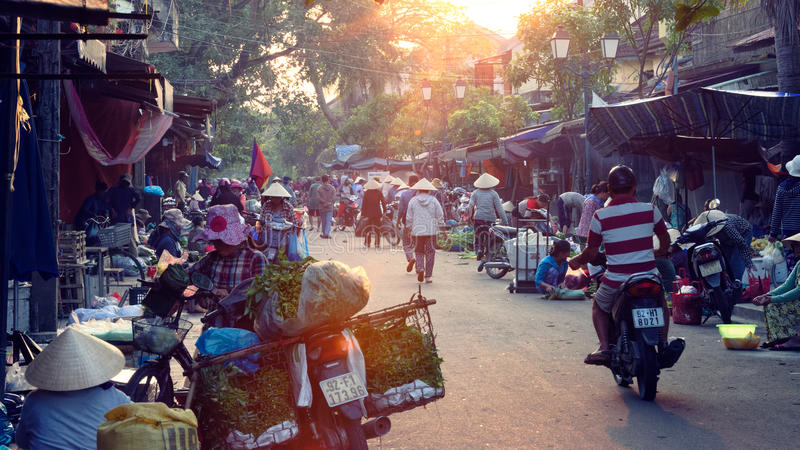 Sunset in Hoi An market. View down rows of roadside traditional markets at sunrise, in Hoi An, Vietnam stock photography
