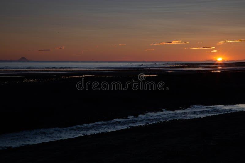 Sunset in Homer, Alaska. Sunset on beach in Homer, Alaska royalty free stock image