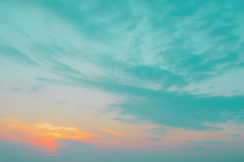 Sunset with horizon abstract bright blue sky and white cloud background stock image