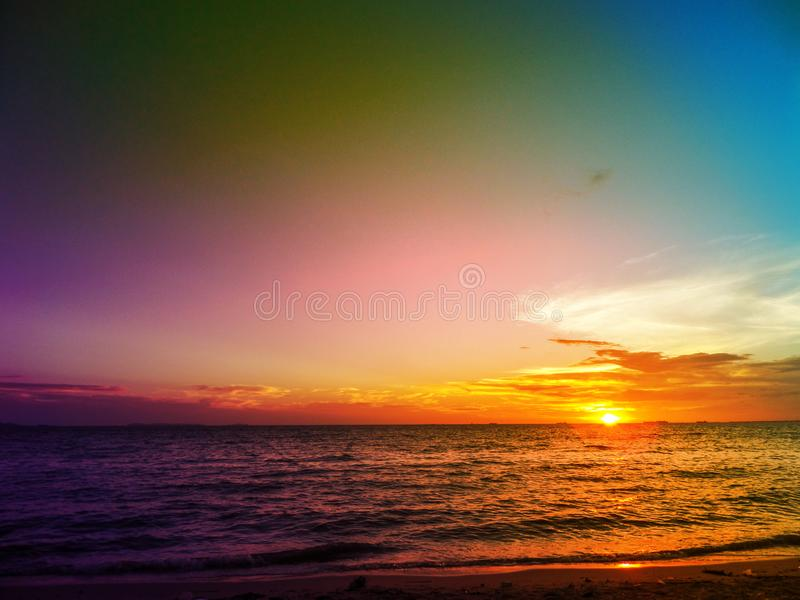 Sunset on horizon line over sea and colorful sky. In evening stock images