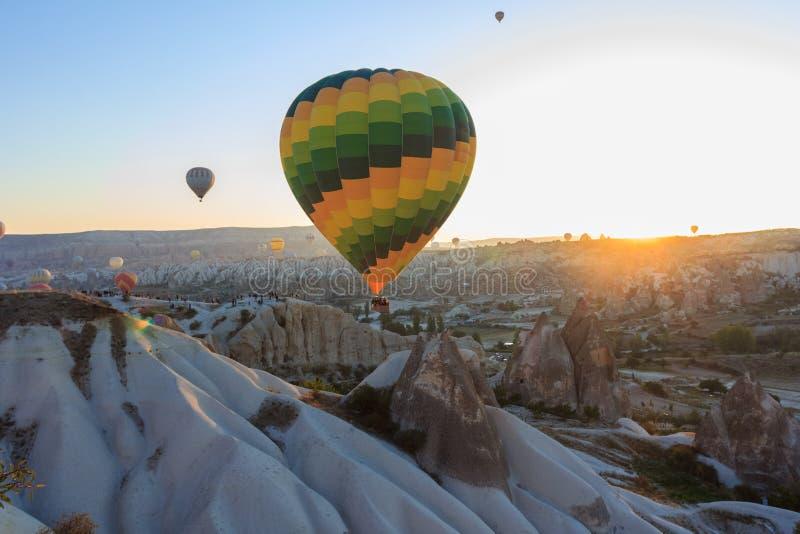 Sunrise with hot air balloons in mountains. Of Cappadocia, Turkey stock photos