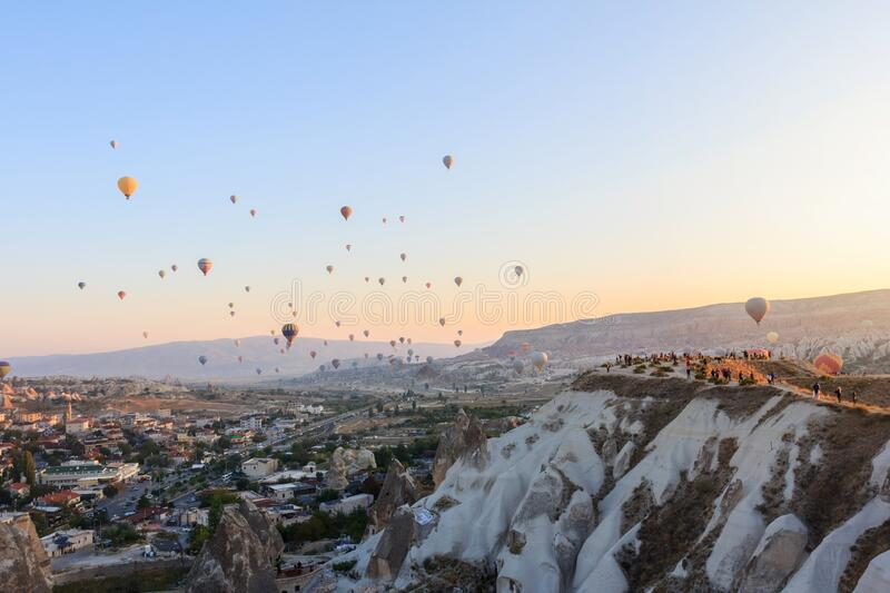 Sunrise with hot air balloons in mountains. Of Cappadocia, Turkey royalty free stock images