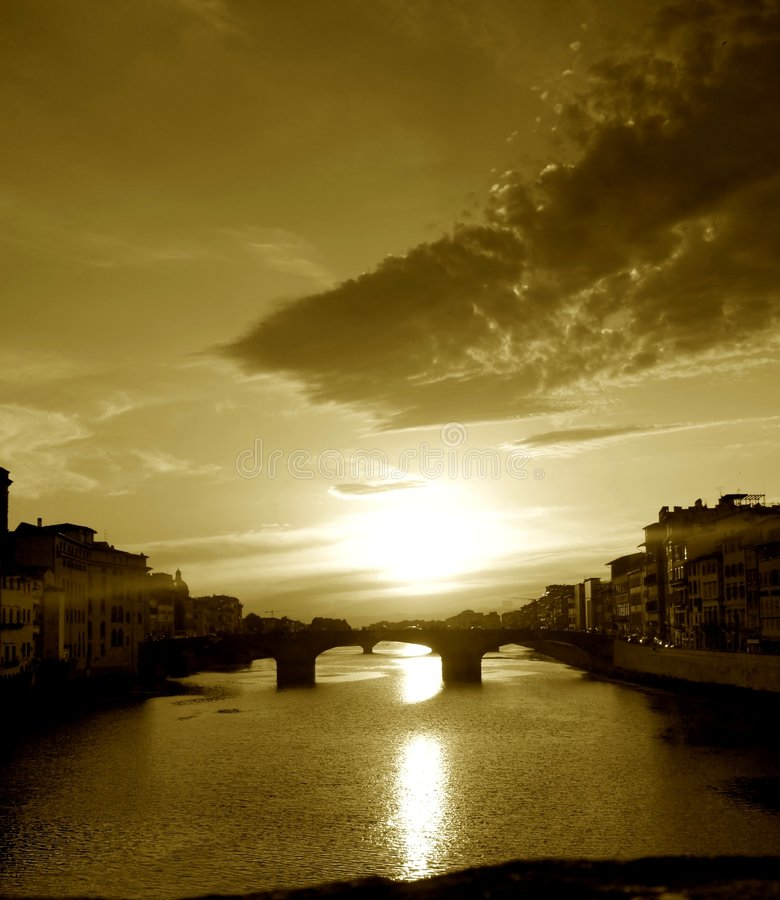 Sunset hour on the Arno river stock photography