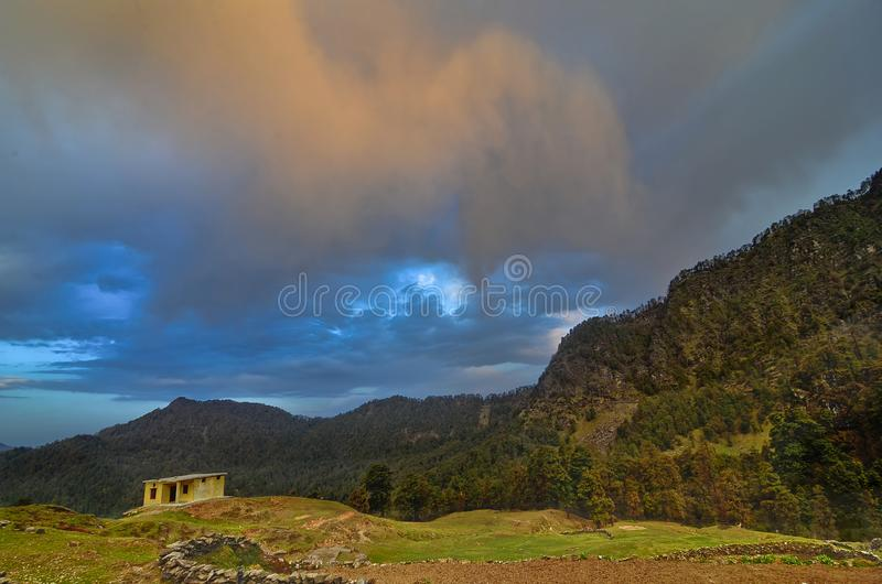 Sunset hues with mountain backdrop at Chopta, Garhwal, Uttarakhand, India stock images