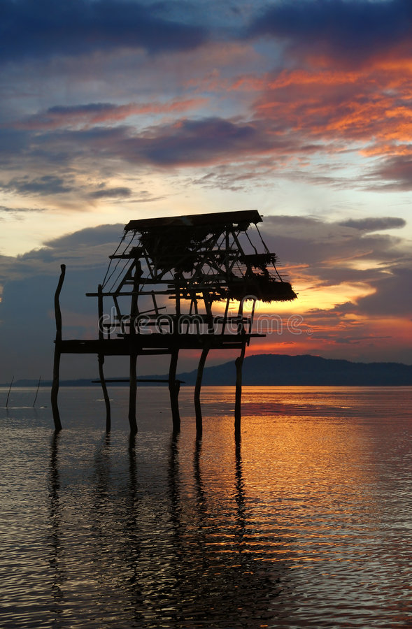 Sunset With Hut Silhouette. Stock Photography
