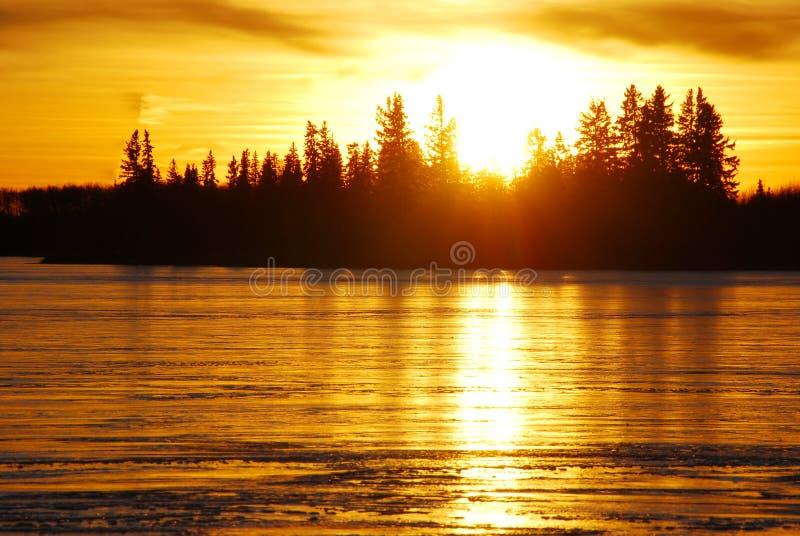 Sunset on the ice lake stock photography