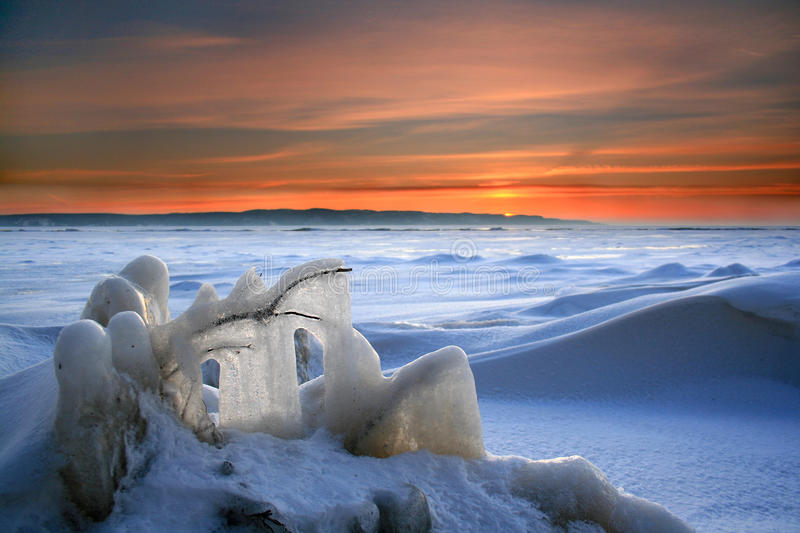 Sunset in the icy wilderness royalty free stock photography