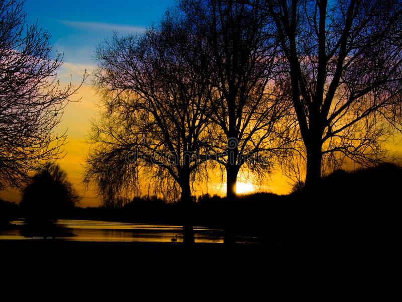 Sunset image at Peterborough Boating Lake, Cambridgeshire, UK. Landscape photo of sunset at Peterborough Boating Lake in Cambridgeshire, UK on a quiet and royalty free stock photography