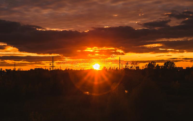 Sunset in the industrial area. Beautiful autumn sunset in an industrial area stock photos