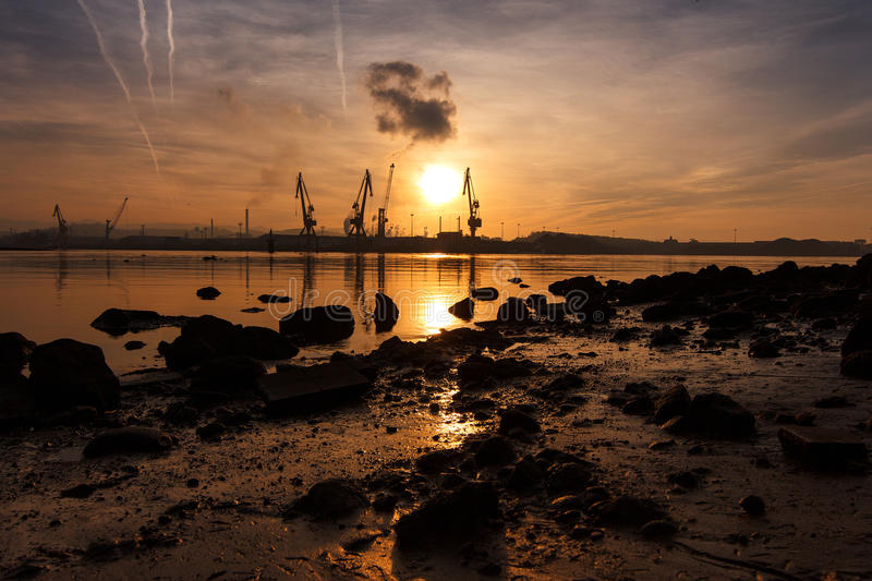 Sunset at industrial landscape royalty free stock photo
