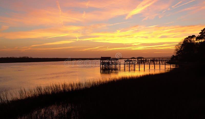 Sunset on the Intercoastal Waterway. Sunset on the boat docks on the Intracoastal Waterway in North Carolina royalty free stock images