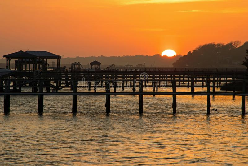 Sunset on the Intracoastal Waterway. Boat docks on the intracoastal waterway as the sun goes down stock photo