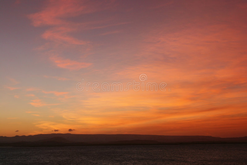 Sunset on a island beach stock photography