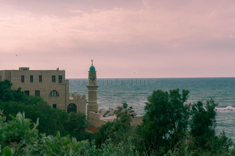 Sunset at Jaffa seashore with a Minareto stock photos
