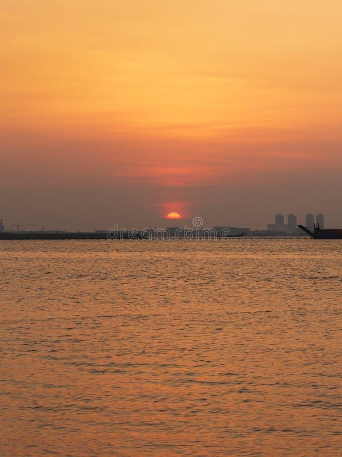 yellow orange sky color on ancol beach. Jakarta, Indonesia stock photos
