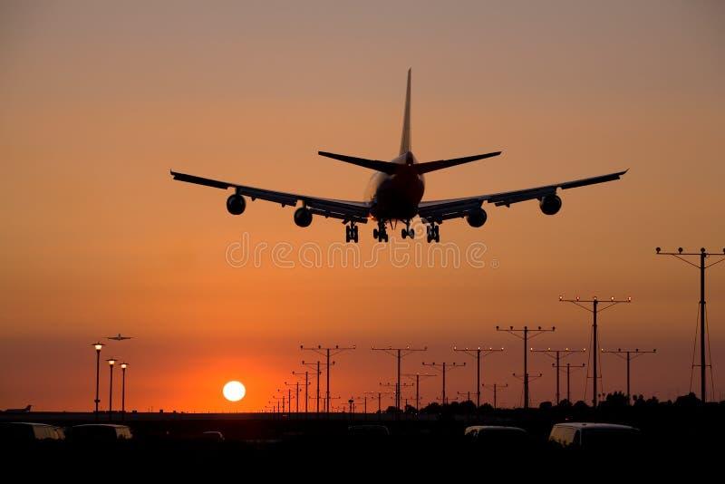 Sunset Jet Landing 2 stock photo