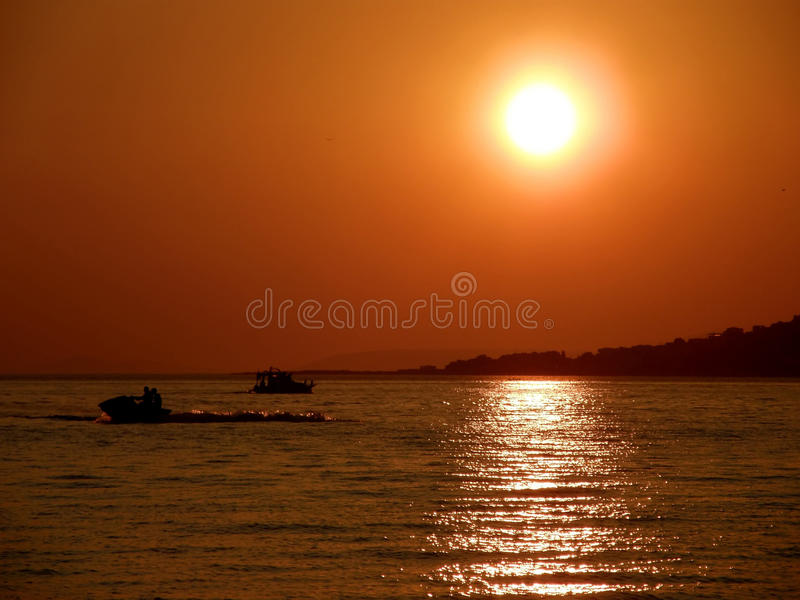 Download Sunset, Jet Ski And Boat Stock Photos - Image: 12770333