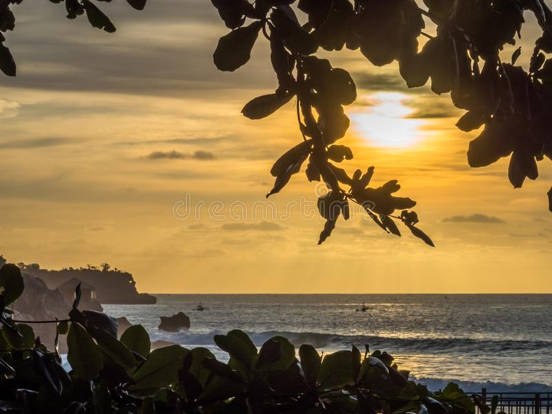 Sunset in Jimbaran Bay Bali with local fishermen in the foreground. On a summers evening royalty free stock photo