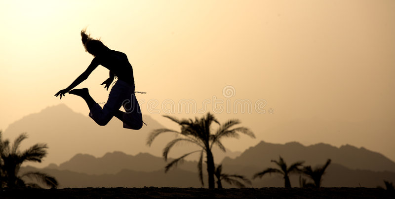 Sunset jumping. 5:40 pm. royalty free stock photo