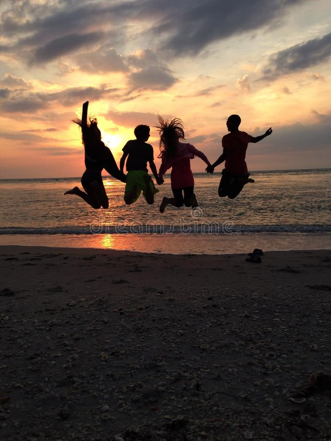 Sunset jumping stock photos