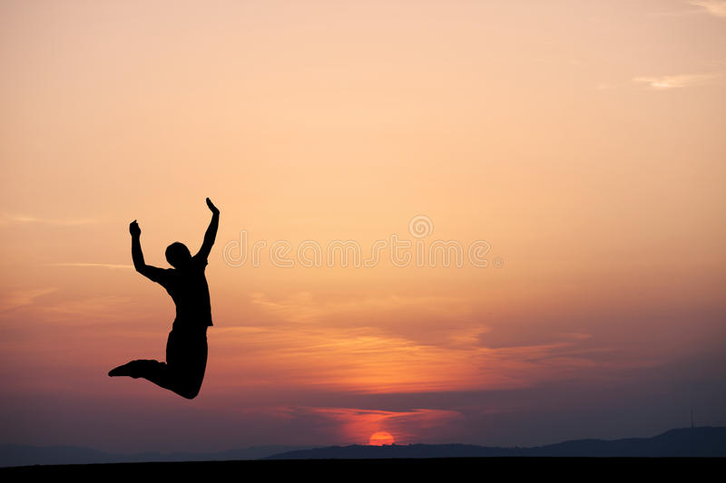 Sunset jumping. Silhouette of man jumping in sunset stock images