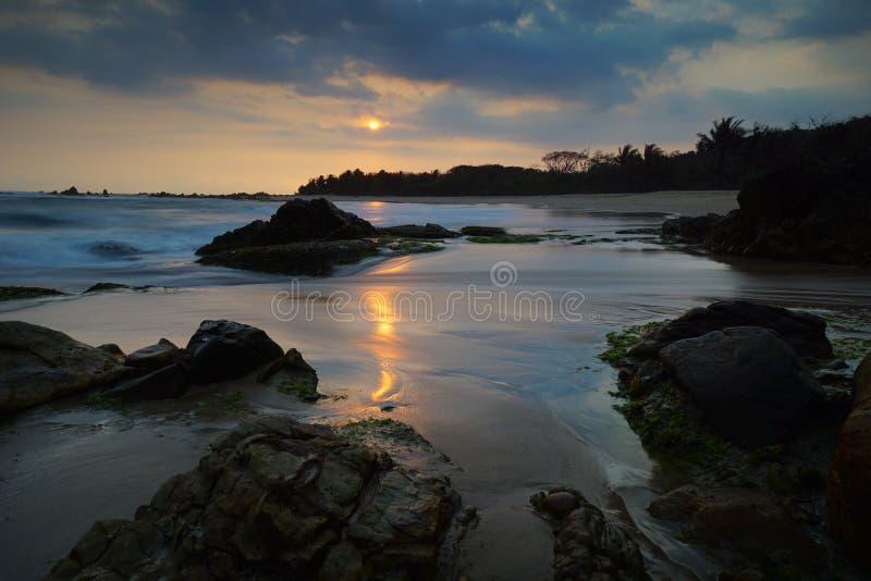 Karang Songsong beach in Banten. Sunset at Karang Songsong beach in Banten stock photography