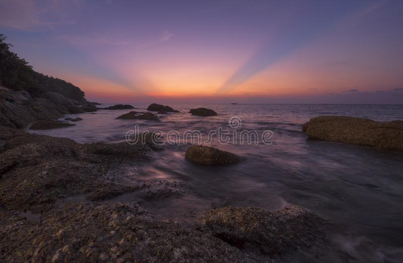 Sunset at Karon beach. Beautiful sky and crepuscular rays at Karon beach, Phuket, Thailand royalty free stock photo